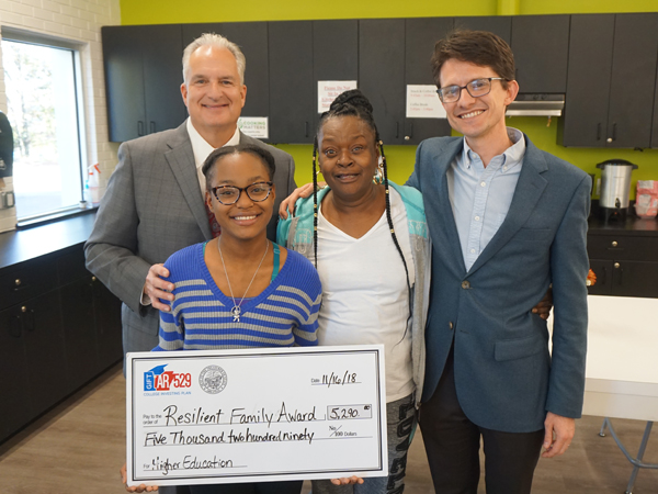 Treasurer Milligan presenting a check in the amount of $5,290 to the 2018 Resilient Family Award winner, LaShunti Natt, and her grandmother. Also pictured is Ben Goodwin, Executive Director of Our House, a shelter for the working homeless that provides resources to families to help them break the cycle of poverty. Arkansas 529 has partnered with Our House for several years to offer $5,290 toward the Resilient Family Award, which is given to one Our House resident each year.