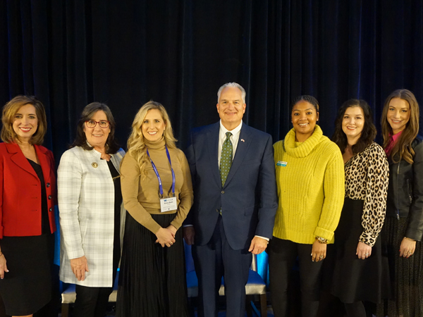 Treasurer Milligan (center) with Auditor Andrea Lea (second from left) and members of the Empowerment Panel pose for a photo during the 2020 Smart Women Smart Money conference. Local KATV Meteorologist Melinda Mayo (left) moderated the panel.