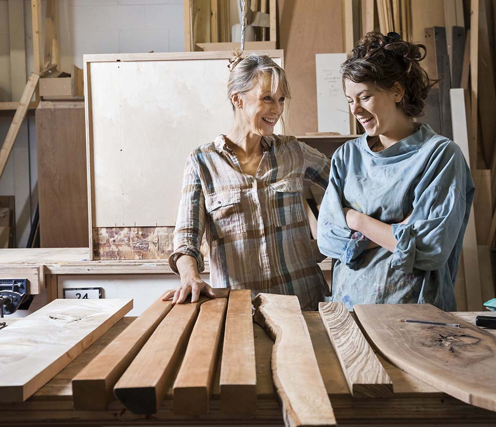AdobeStock_145742057 copy.jpg (Two women choosing wood from a selection...
