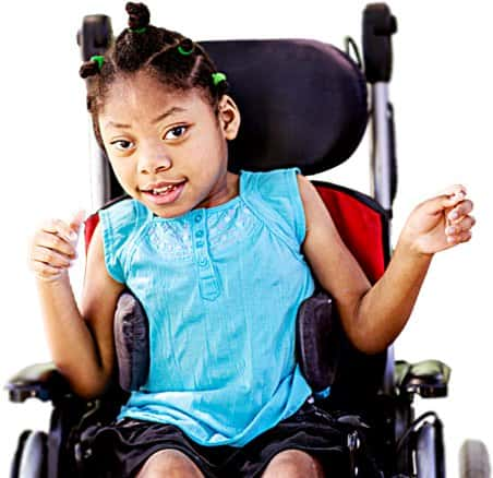 A young girl, smiling in a wheelchair.