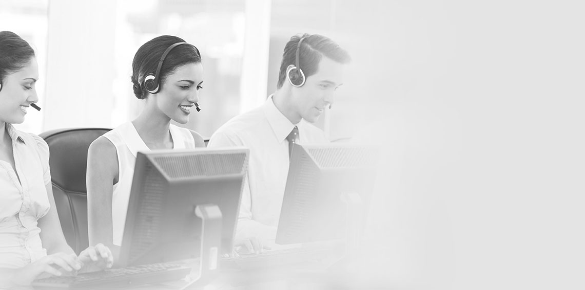 Call centre employees smiling while sitting