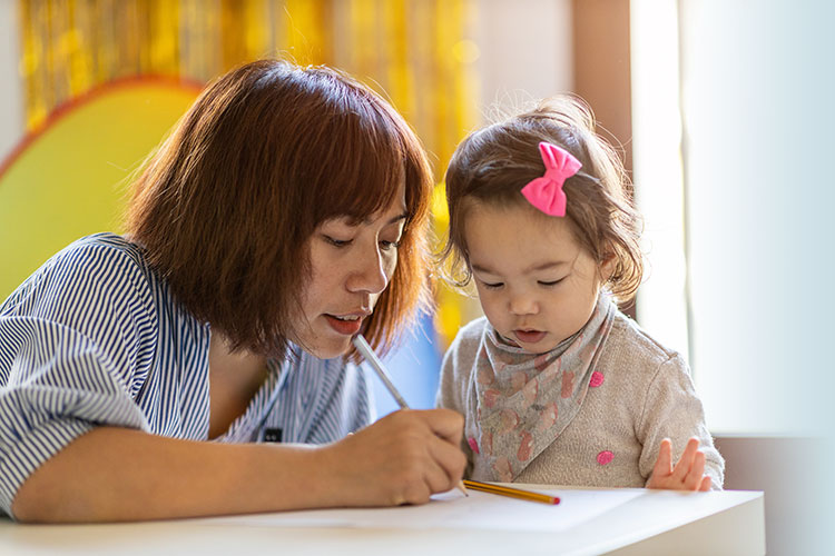 mom and daughter doing homework