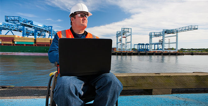 Man sitting down using a laptop